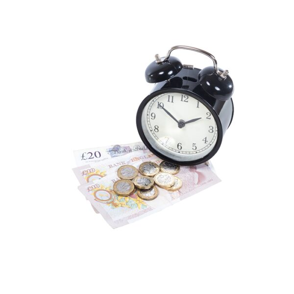 A photo of money and an alarm clock