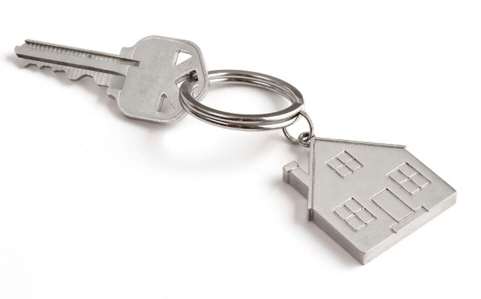 Photograph of key with house shaped key fob