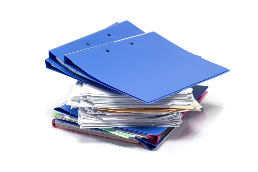 Photograph of pile of case files