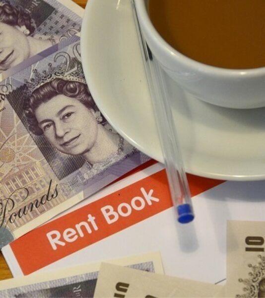 Photograph of rent book and rent money